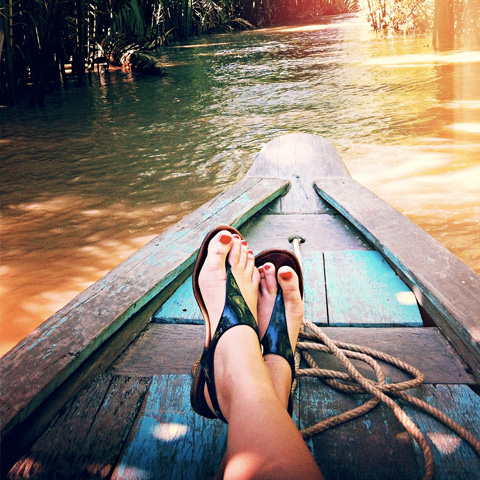 Woman's feet on canoe