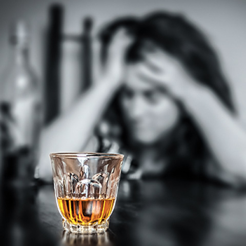Woman regretting drinking alcohol